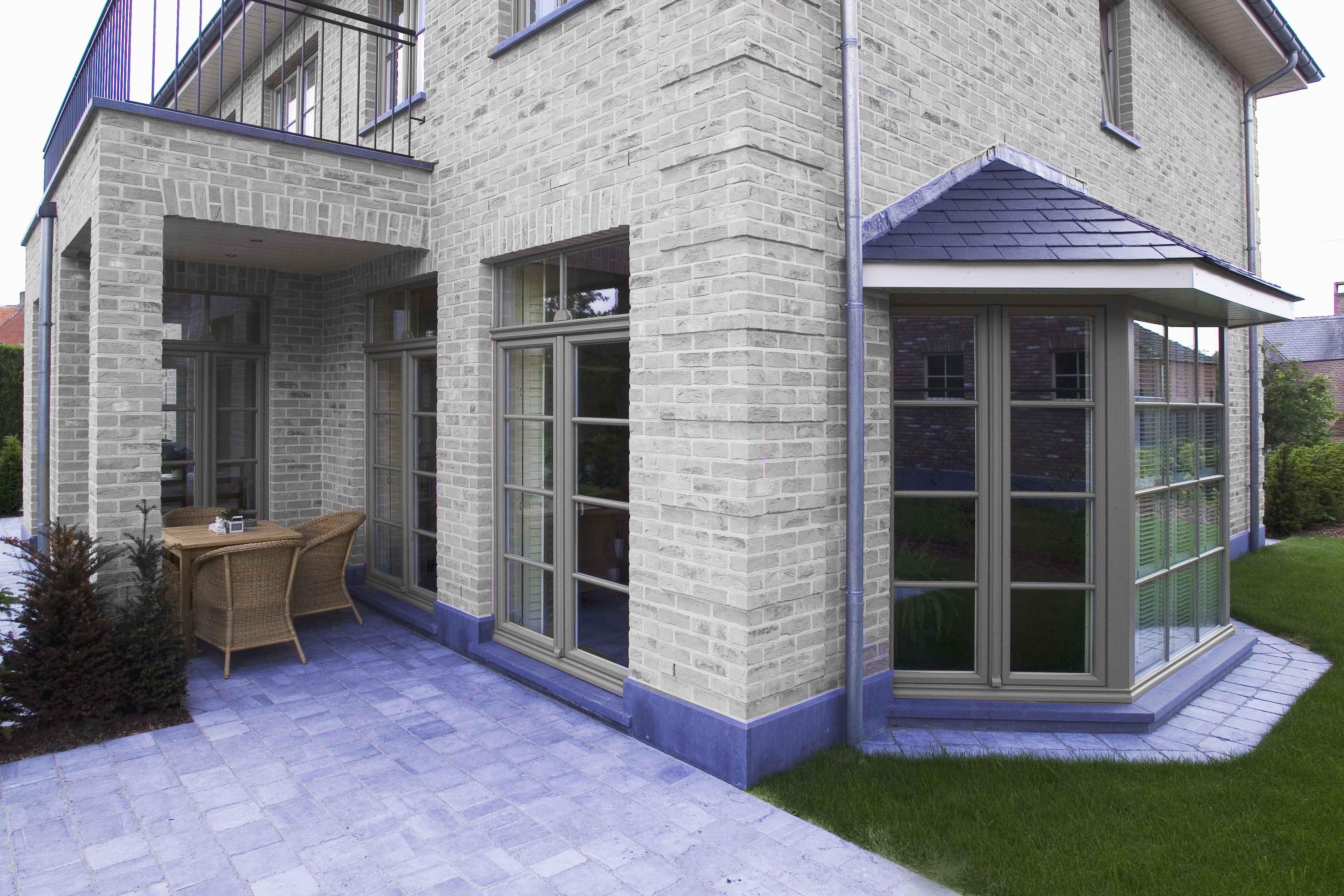 Klassieke woning met trapeziumvormige erker.
